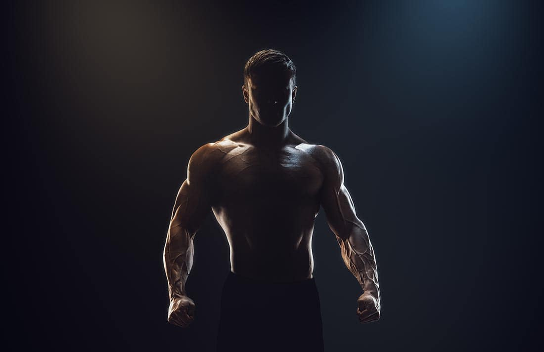 Male Bodybuilder in back light