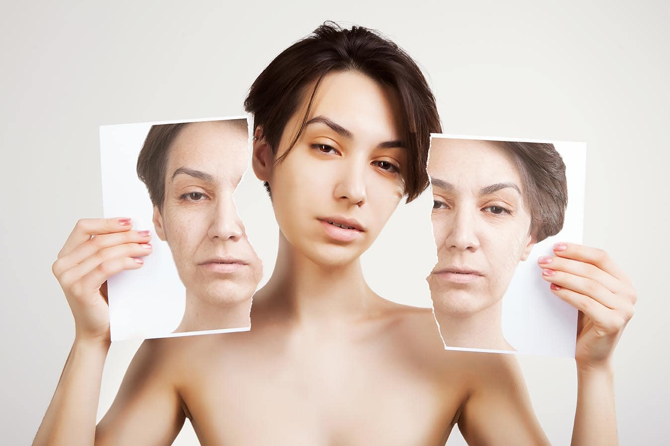 Woman showing pictures from before and after